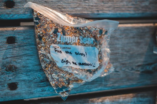 Zipper bag with bird feed and inscriptions