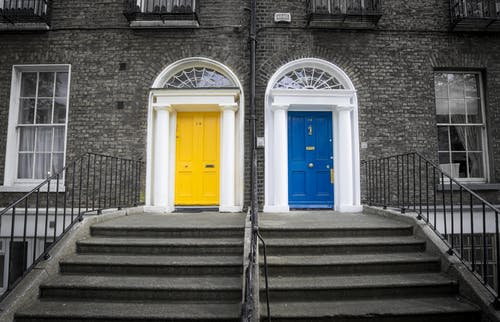 Two Closed Yellow and Blue Doors
