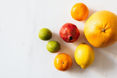 Composition of ripe fruits on white table