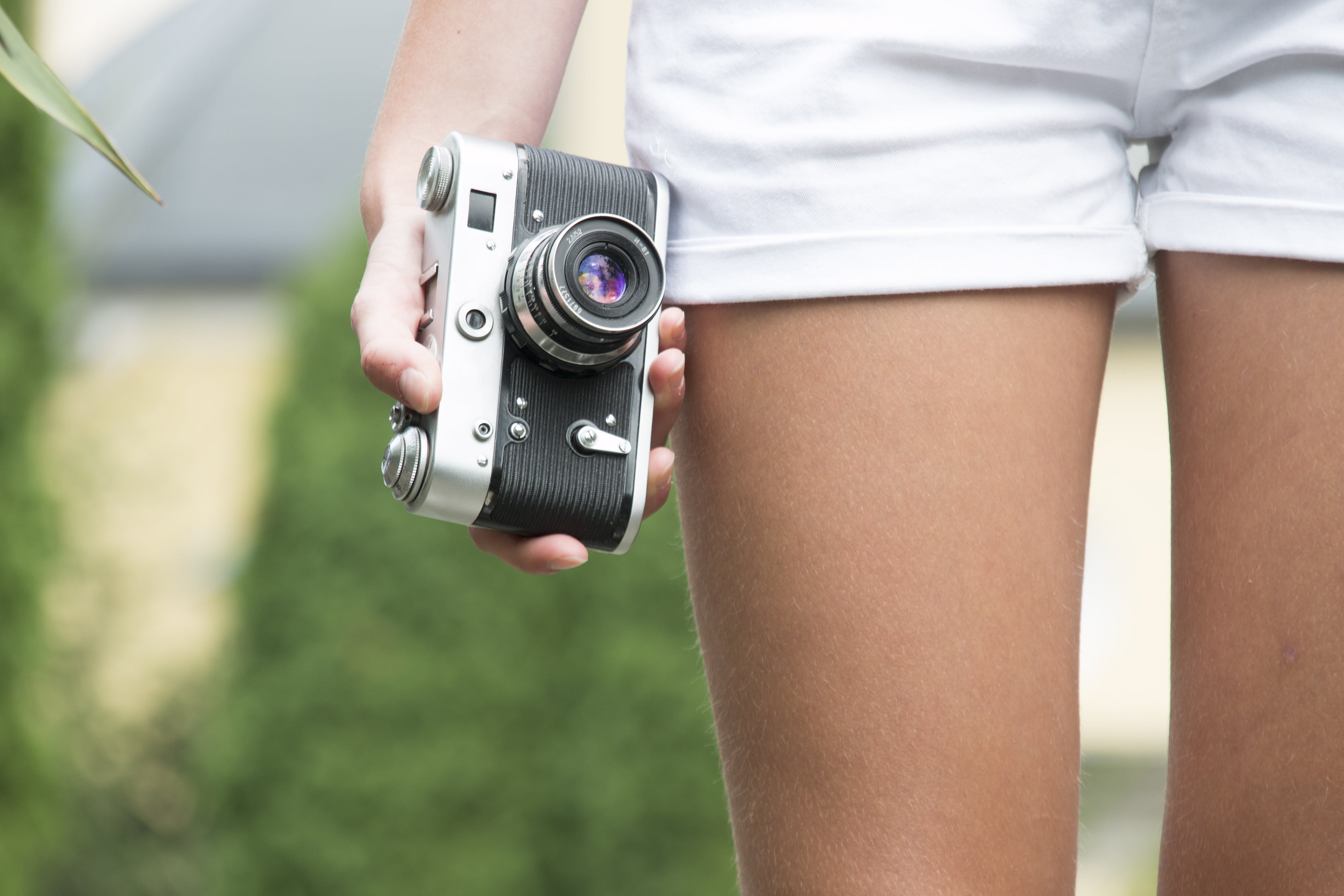 Person Holding Black and White Camera