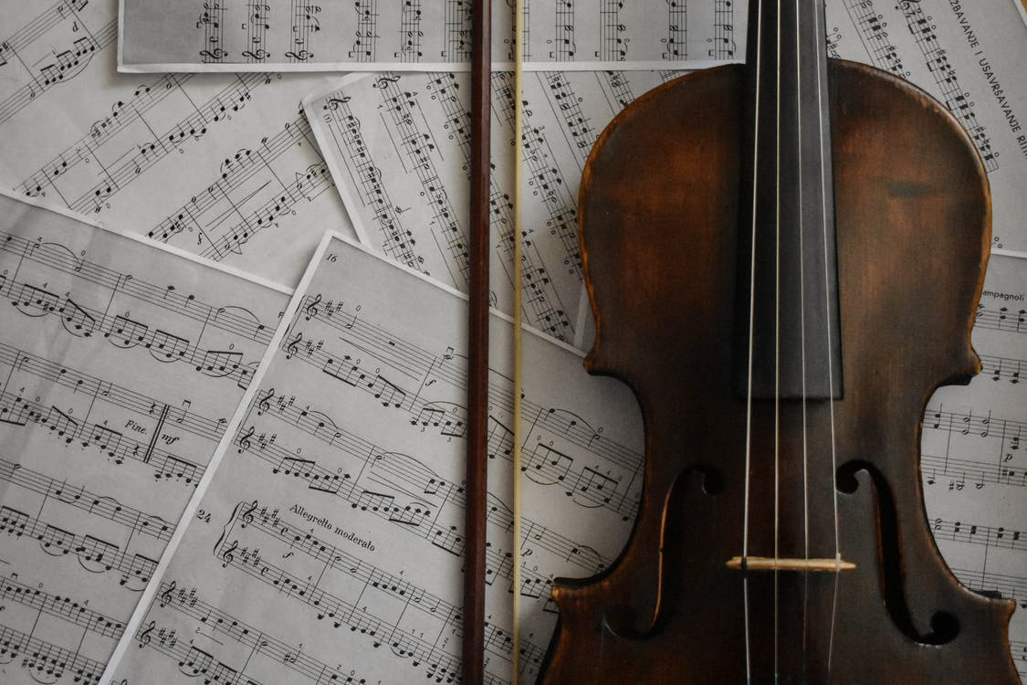 Brown Violin on Musical Notes