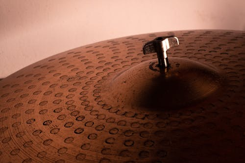 Metal cymbals with geometric pattern on surface
