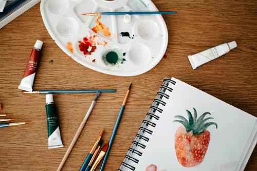 White Ceramic Plate With Assorted Color Pencils and Pencils