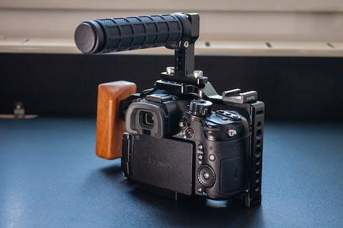 Black Camera on Blue Table