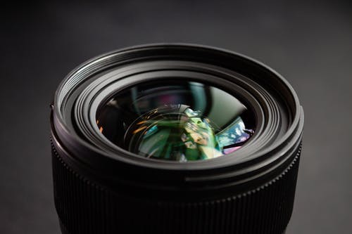 Black Camera Lens With Green and Blue Dragon Print