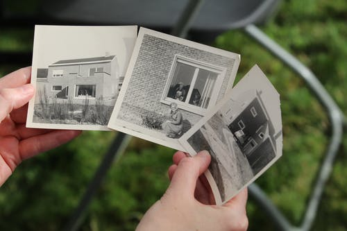 Person Holding White and Black Photo