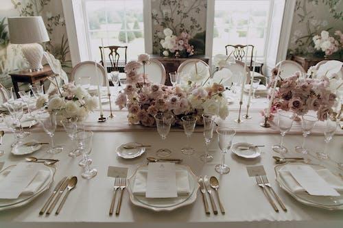 White Ceramic Plates on Table