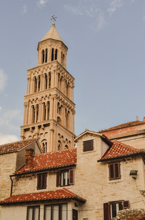 Old masonry Palace of Diocletian under cloudy sky in town