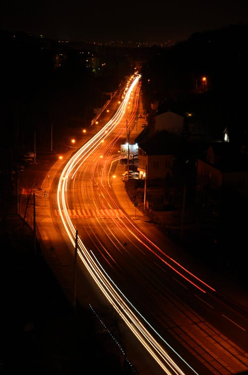 Illuminated busy highway in suburb at night