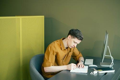 Man Drawing on his Sketchbook