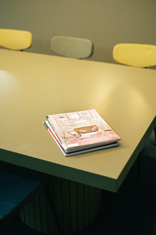 Magazines on a Green Table