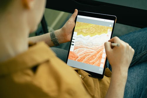 Person Drawing on a Tablet