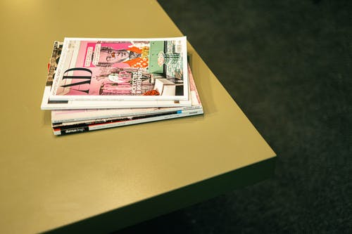 Stack of Magazines on a Table
