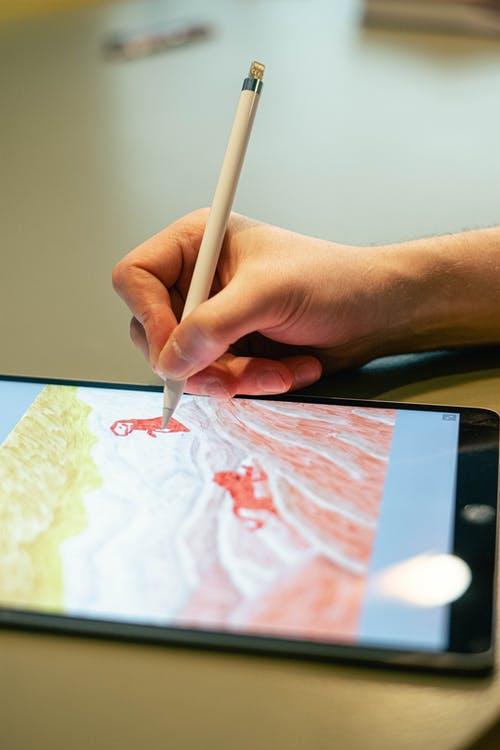 Person Sketching on a Tablet