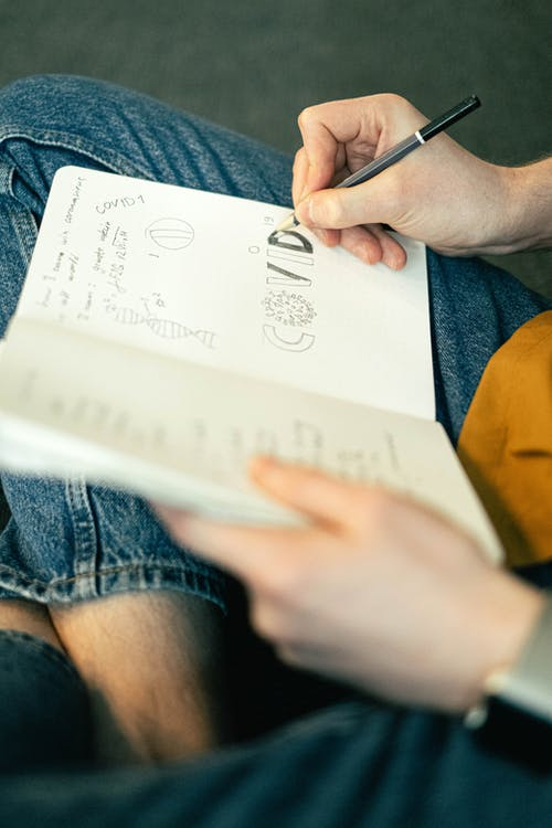 Foto profissional grátis de caderno, caderno de desenho, caderno de desenhos, caucasiano