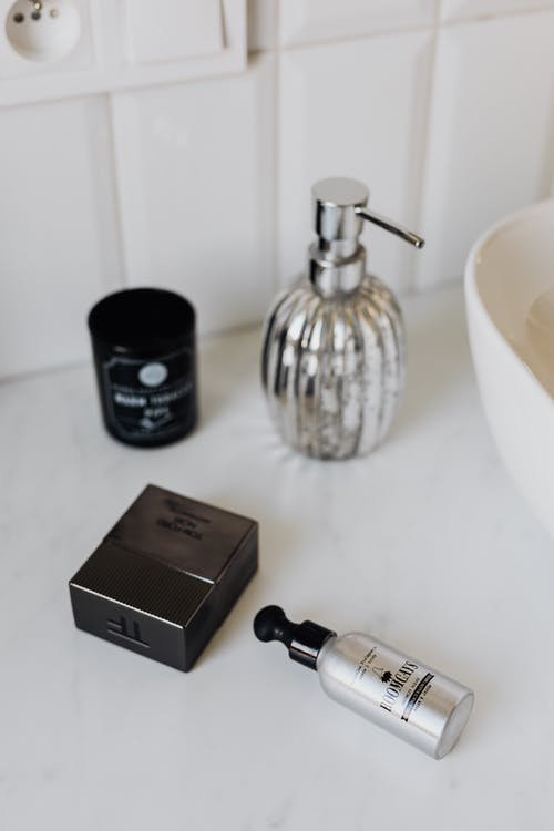 Cosmetic set and perfume in stylish bathroom