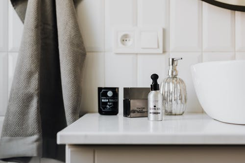 Personal care supplies on cabinet in stylish bathroom