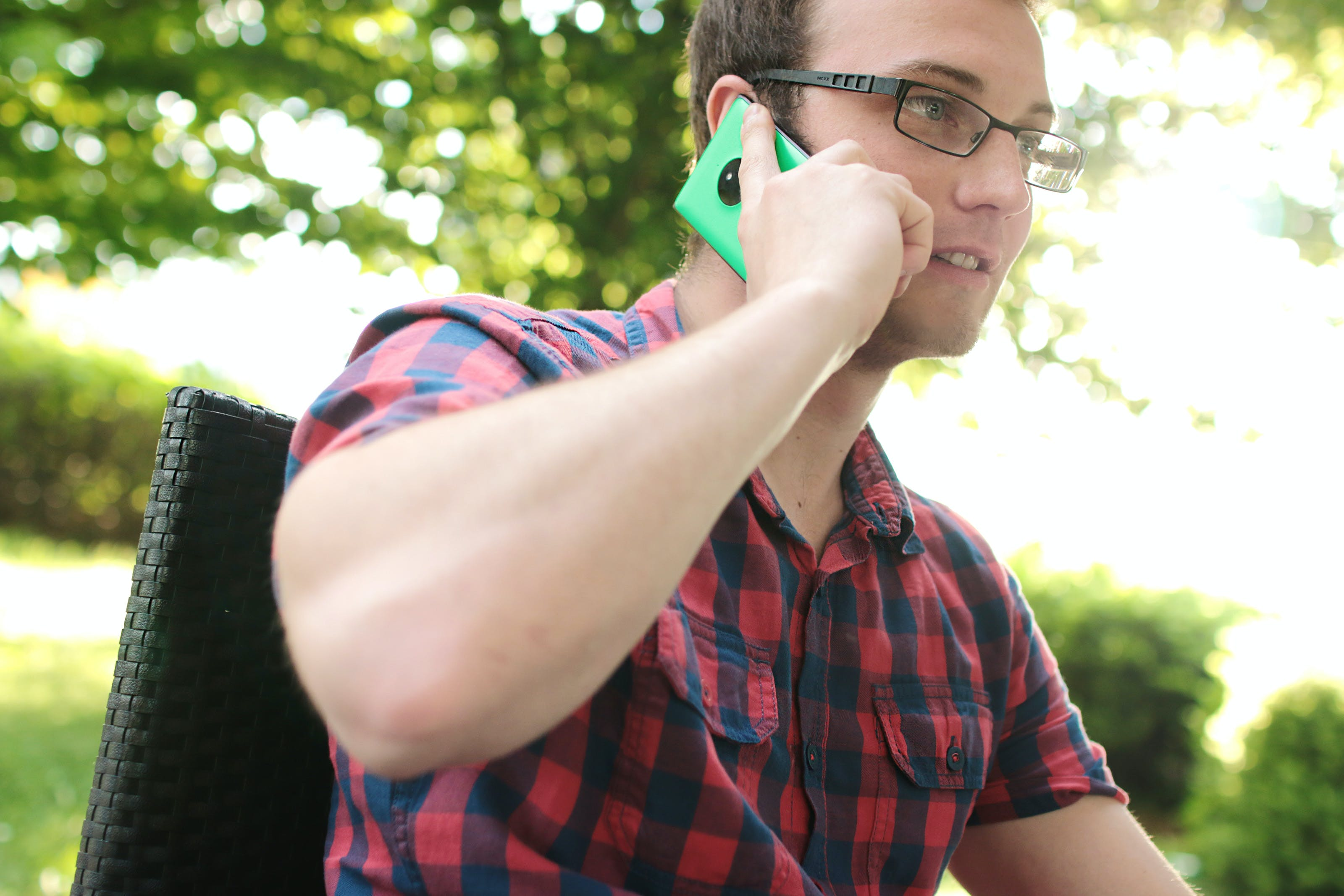 Man Placing His Phone on His Right Ear