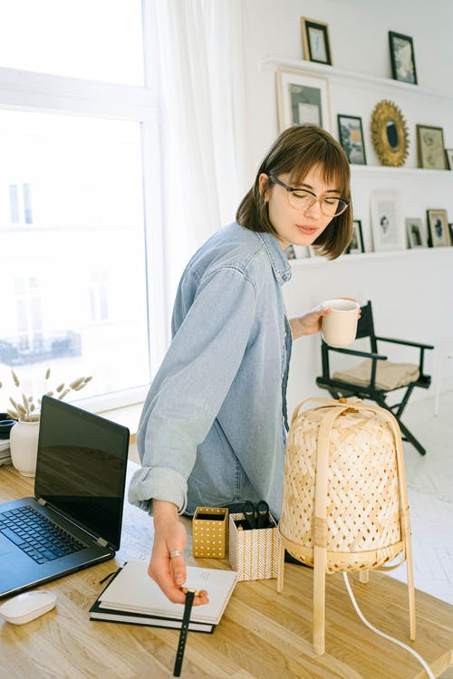 Woman Checking Time in Office