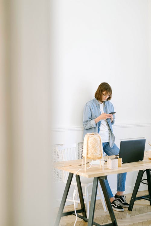 Woman Checking Smartphone