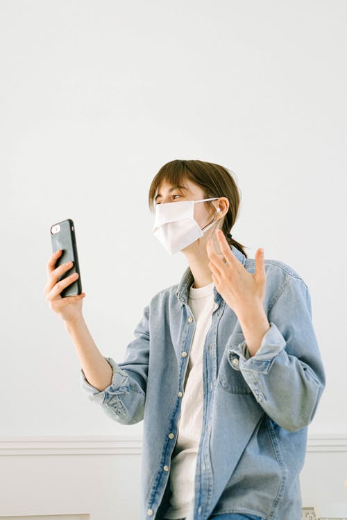 Woman With a Face Mask having a Video Call