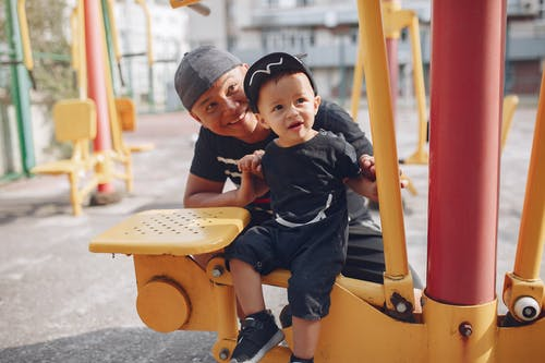 Father and cute son on playground