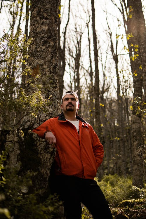 Man in Red Jacket Standing Near Tree