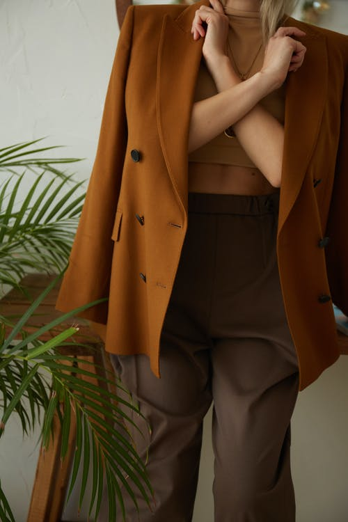 Person in Brown Coat and Gray Pants