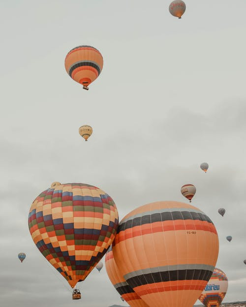 Colorful air balloons flying in overcast sky