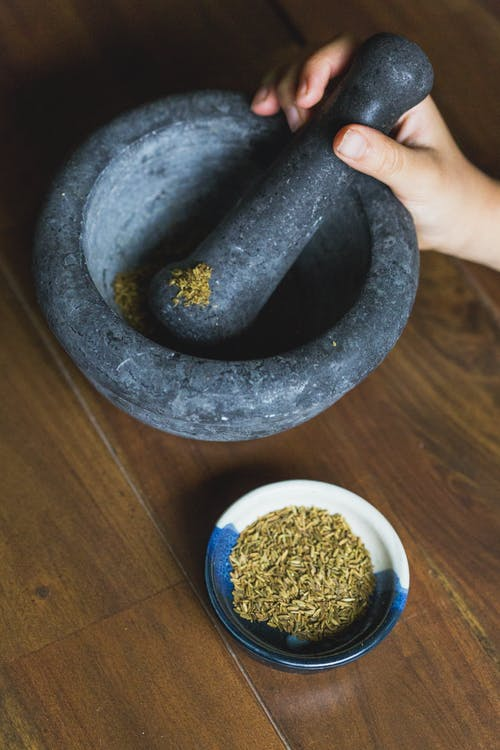 White Powder in Round Gray Mortar and Pestle