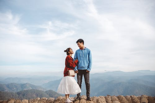 Couple Standing on Rock Formation