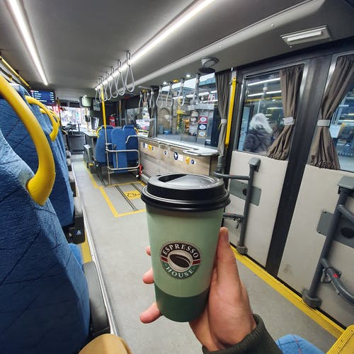 Free stock photo of bus ride, Bus with coffee, coffee cup, Coffee in bus