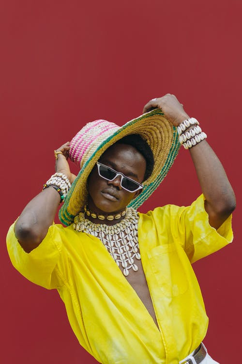 Woman in Yellow Shirt Wearing Sunglasses and Brown Straw Hat