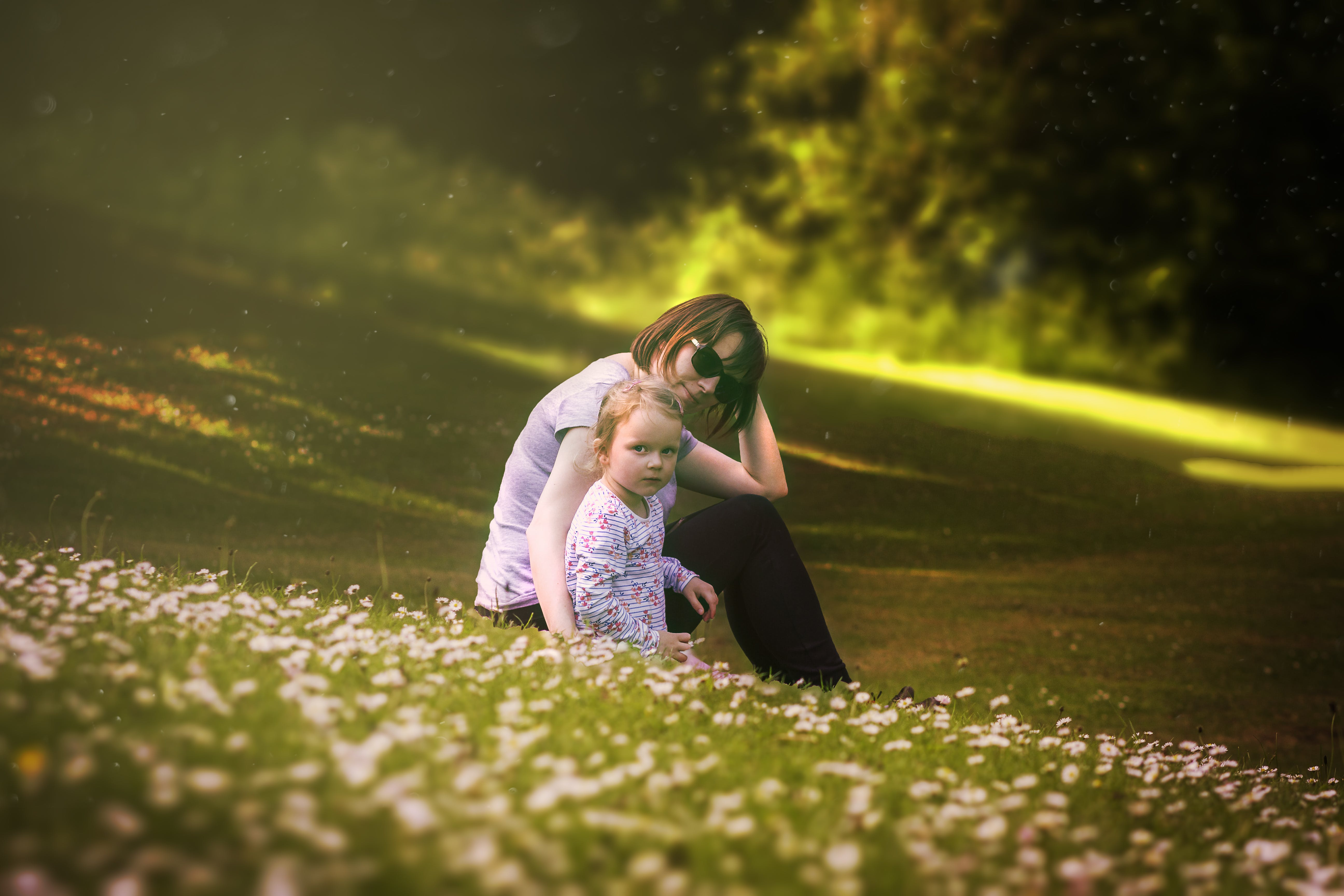 Woman and Baby Sitting on Flower Field
