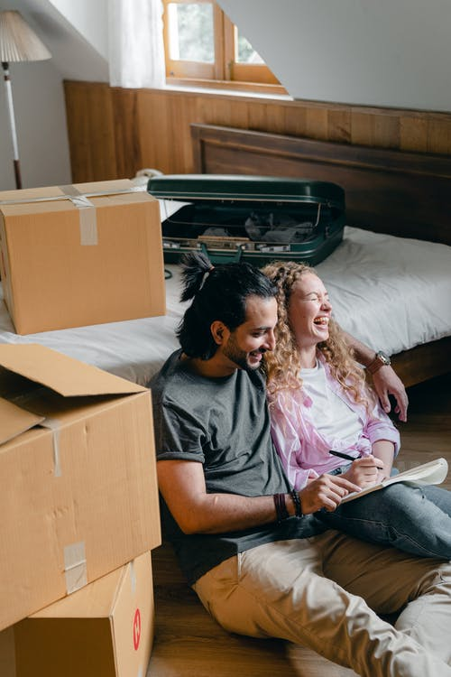 Happy adult husband and wife moving in new home