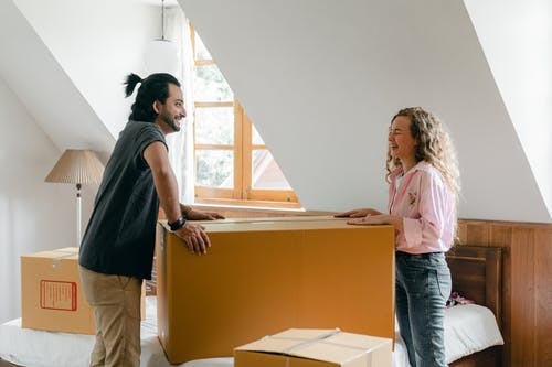 Smiling diverse couple moving in new house