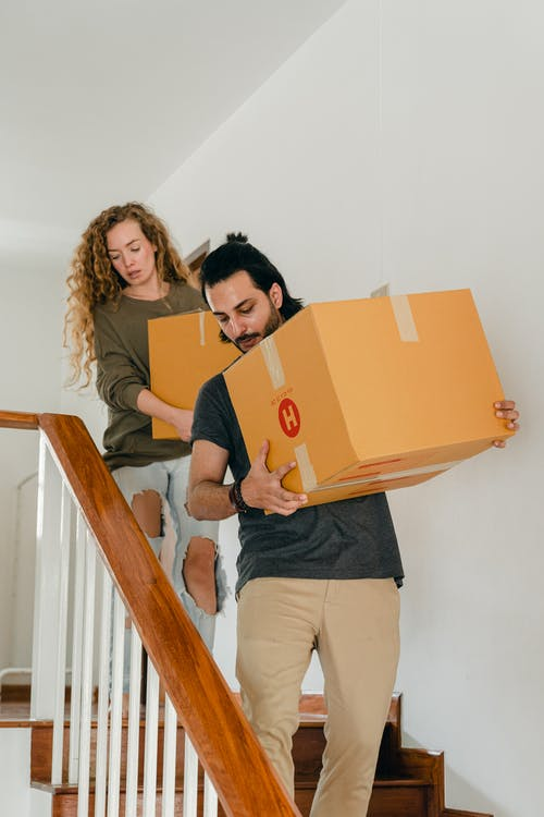 Young diverse couple moving into new house