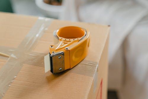 Packing tape gun on carton box