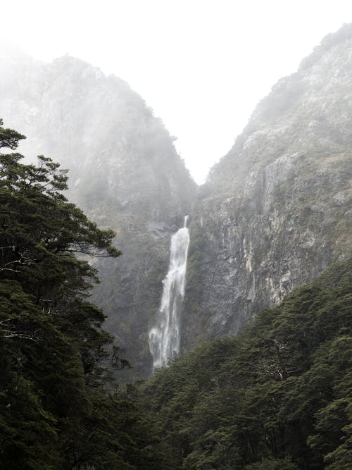 Photography of Waterfalls Between Mountain