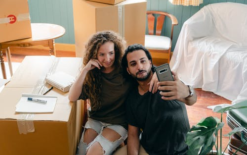 Content couple taking selfie on smartphone