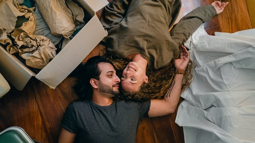 Loving couple resting on floor together