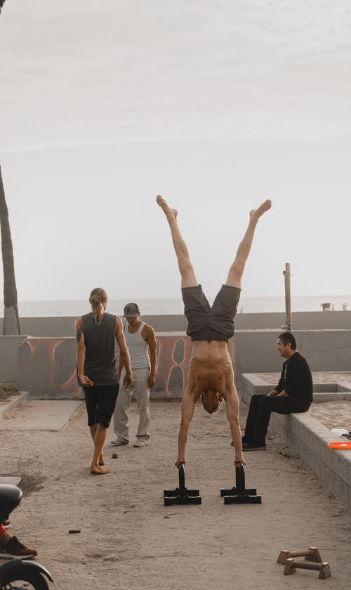 Group of Men Exercising Outdoors
