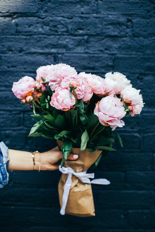 Person Holding Pink Peony Bouquet