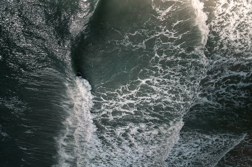 Stormy sea water with foamy waves