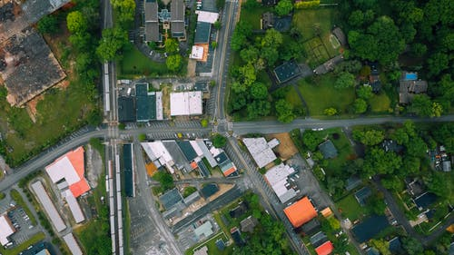 Aerial view suburban area with residential cottages and commerce buildings