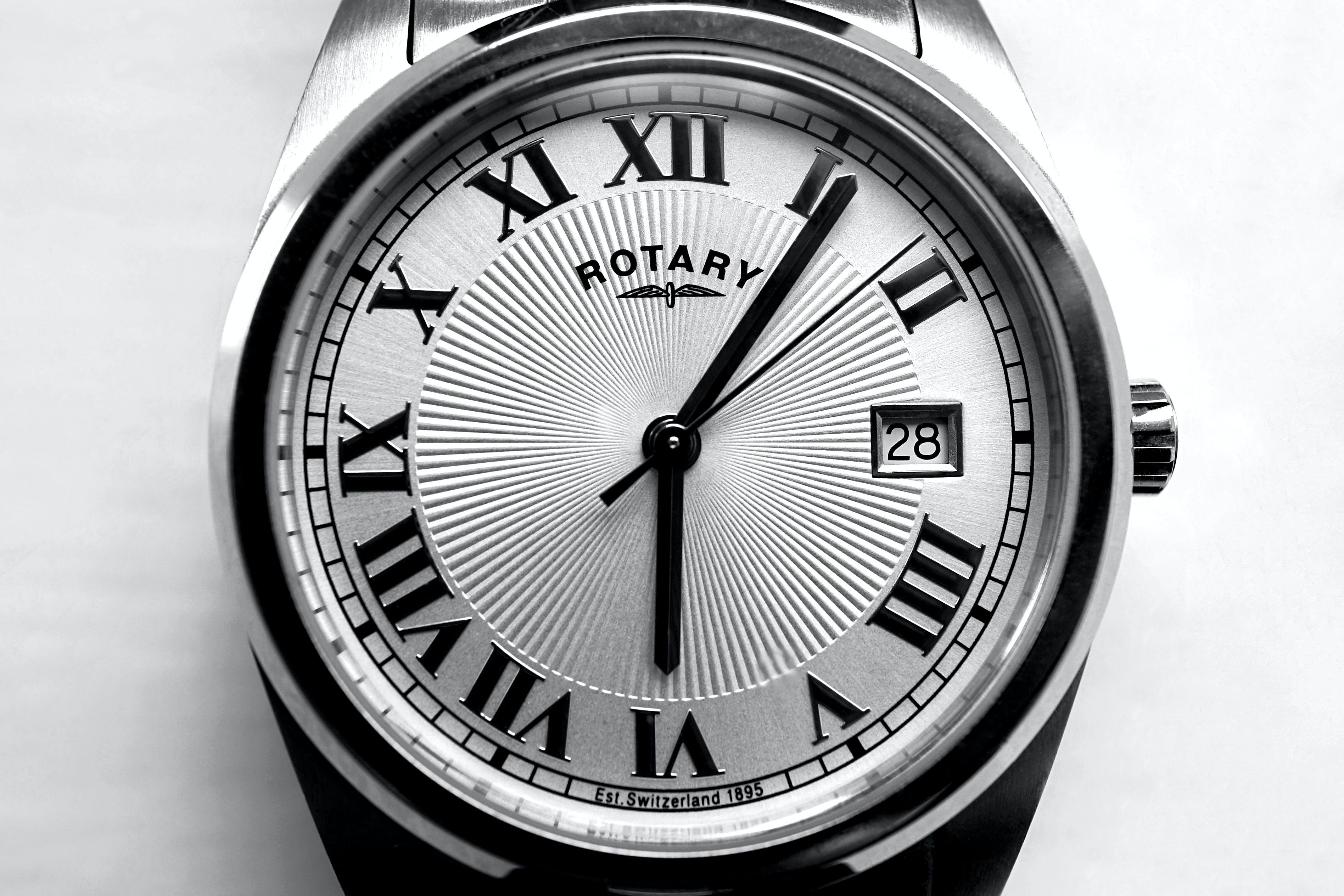 Round Gray Rotary Analog Watch 6:06 Display