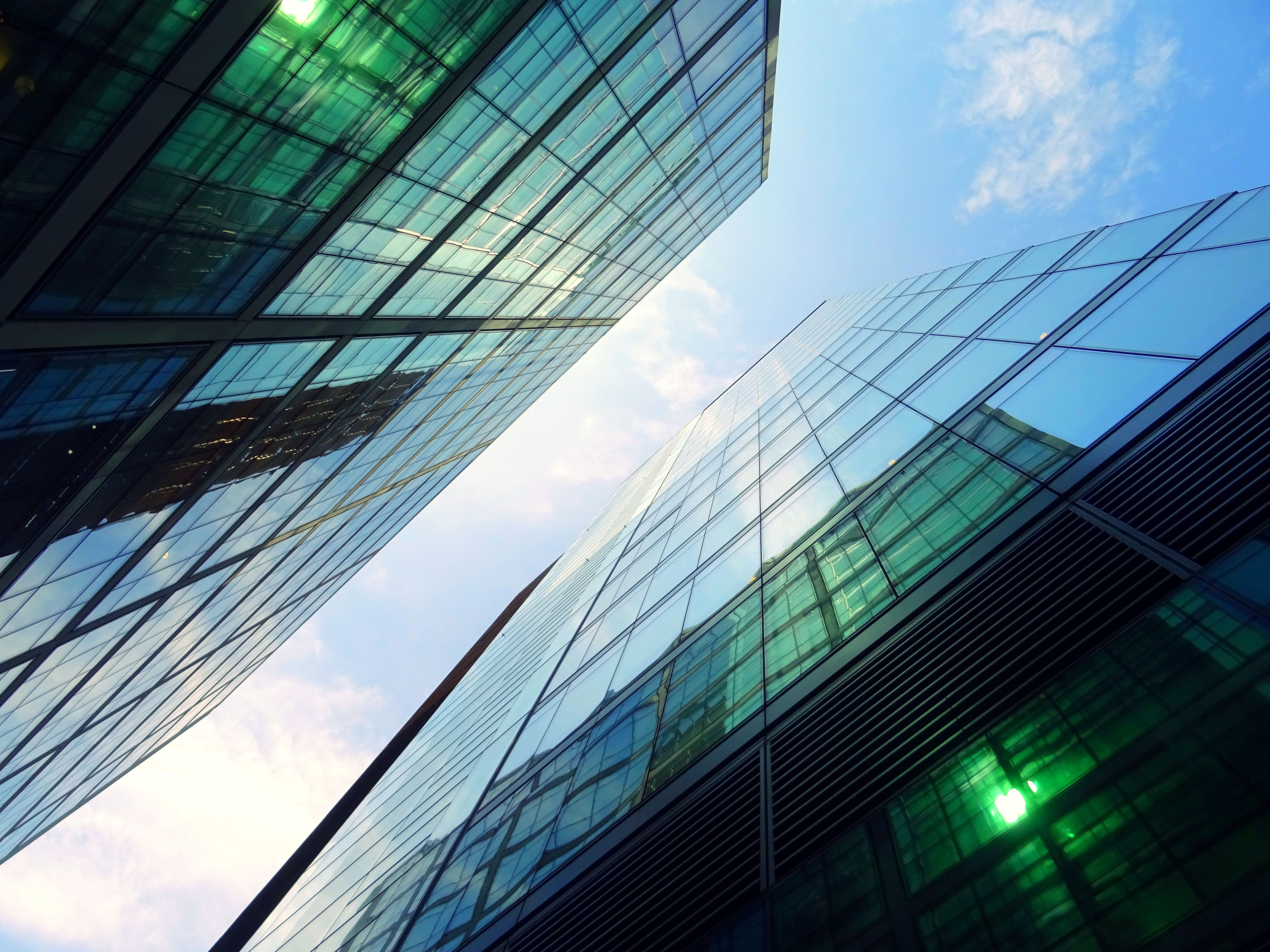 Low-angle Photography of Two Green Curtain Buildings