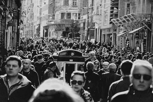Overcrowded busy street on narrow city street
