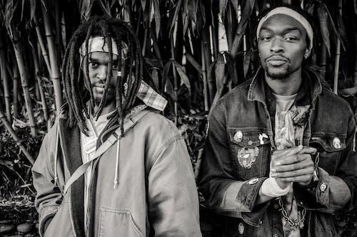 Content black men in tropical park