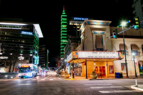 Urban street with illuminating lights at night